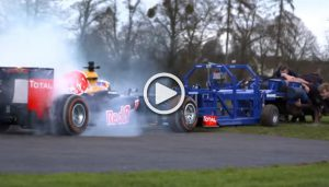 Red Bull F1 Car against 8 strong rugby players